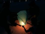 Lighting a sky lantern